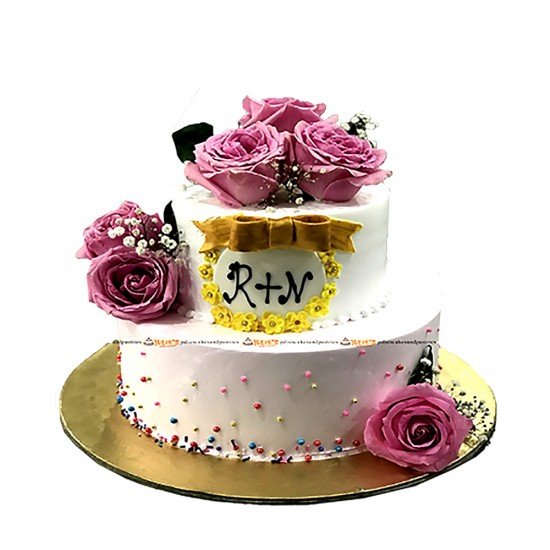 Elegant 2 tiered Wedding special cake with Fresh Flowers